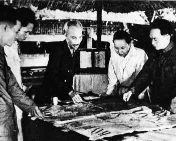 Vo Nguyen Giap, far right, discusses military operations with President Ho Chi Minh, center, during the historic battle of Dien Bien Phu, in which Vietnamese forces defeated the French i