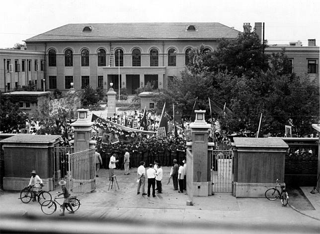Red Guards mass outside the British embassy gates in Beijing during the Cultural Revolution in the late 1960s.